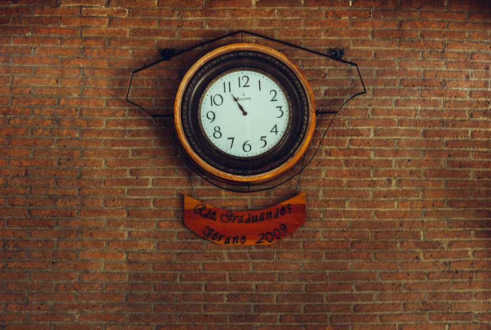 round brown and black analog wall clock