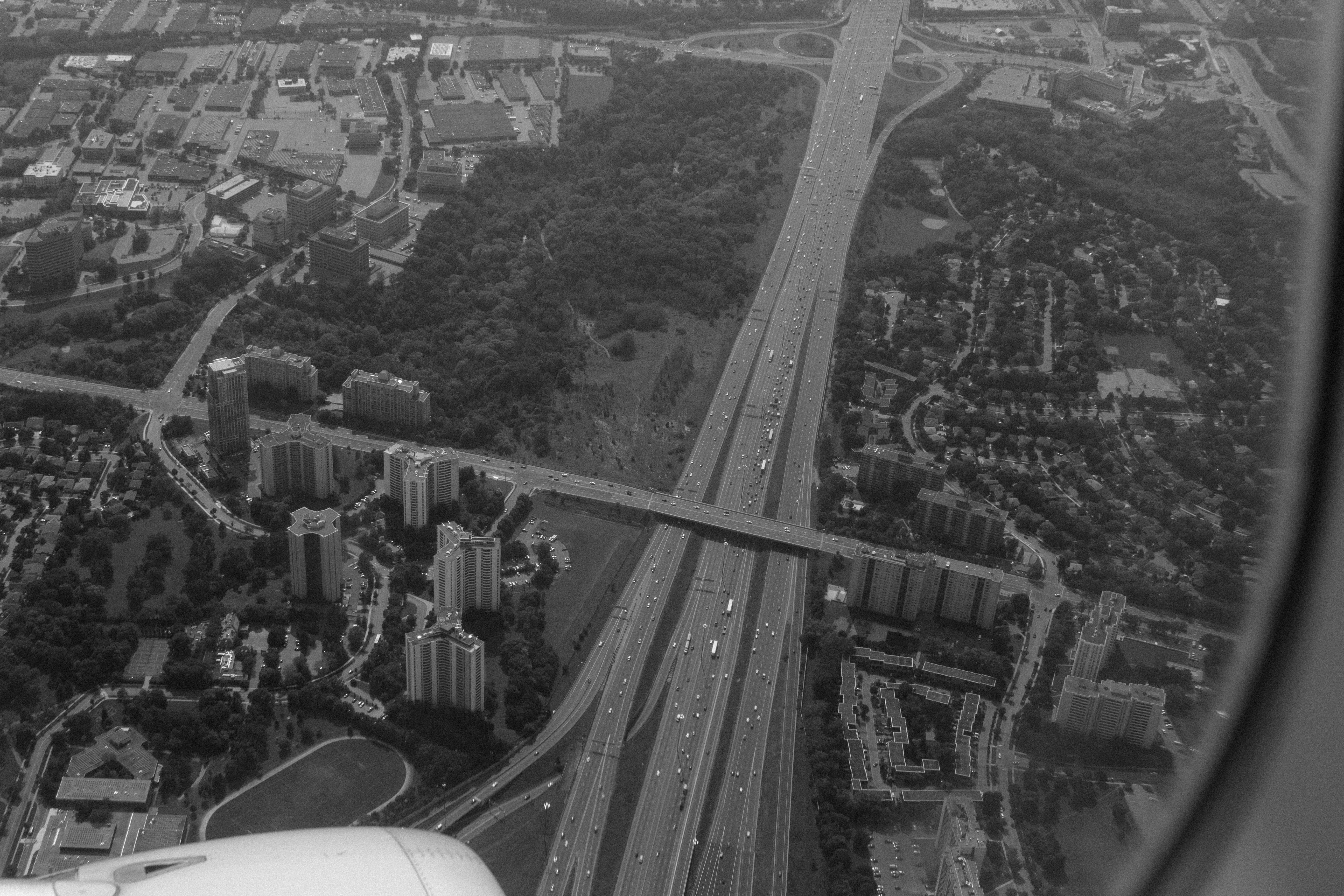 aerial grayscale photography of vehicles passing highway