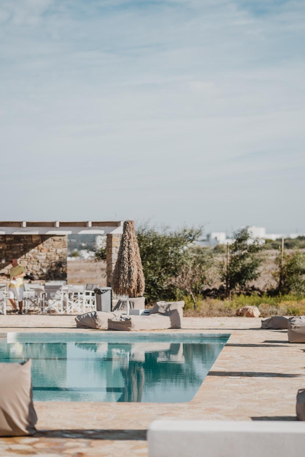 rectangular white outdoor swimming pool