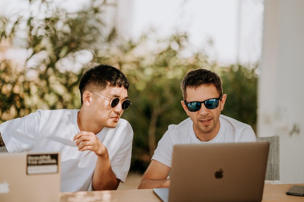 men in front of laptop