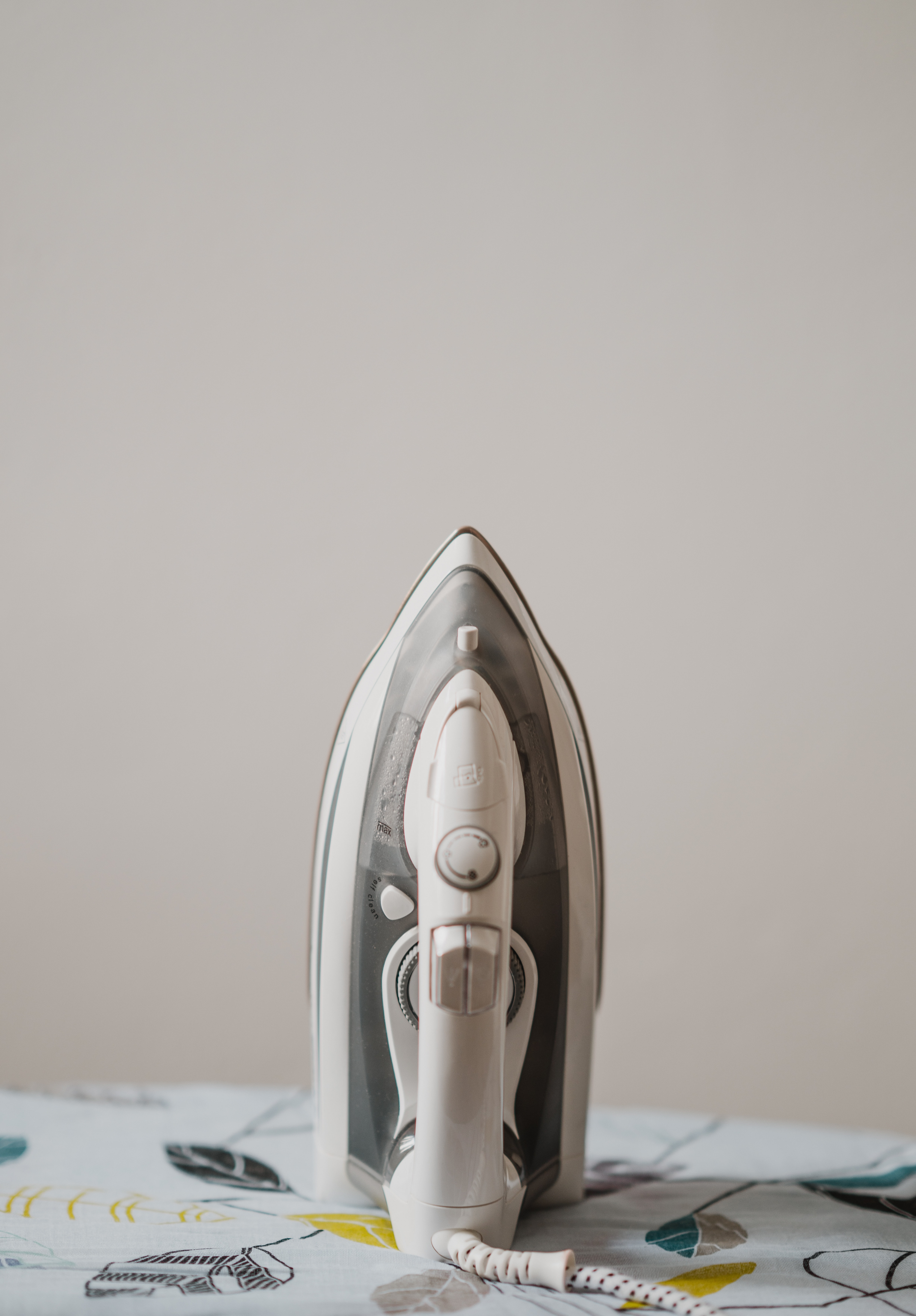 used white and gray steam iron
