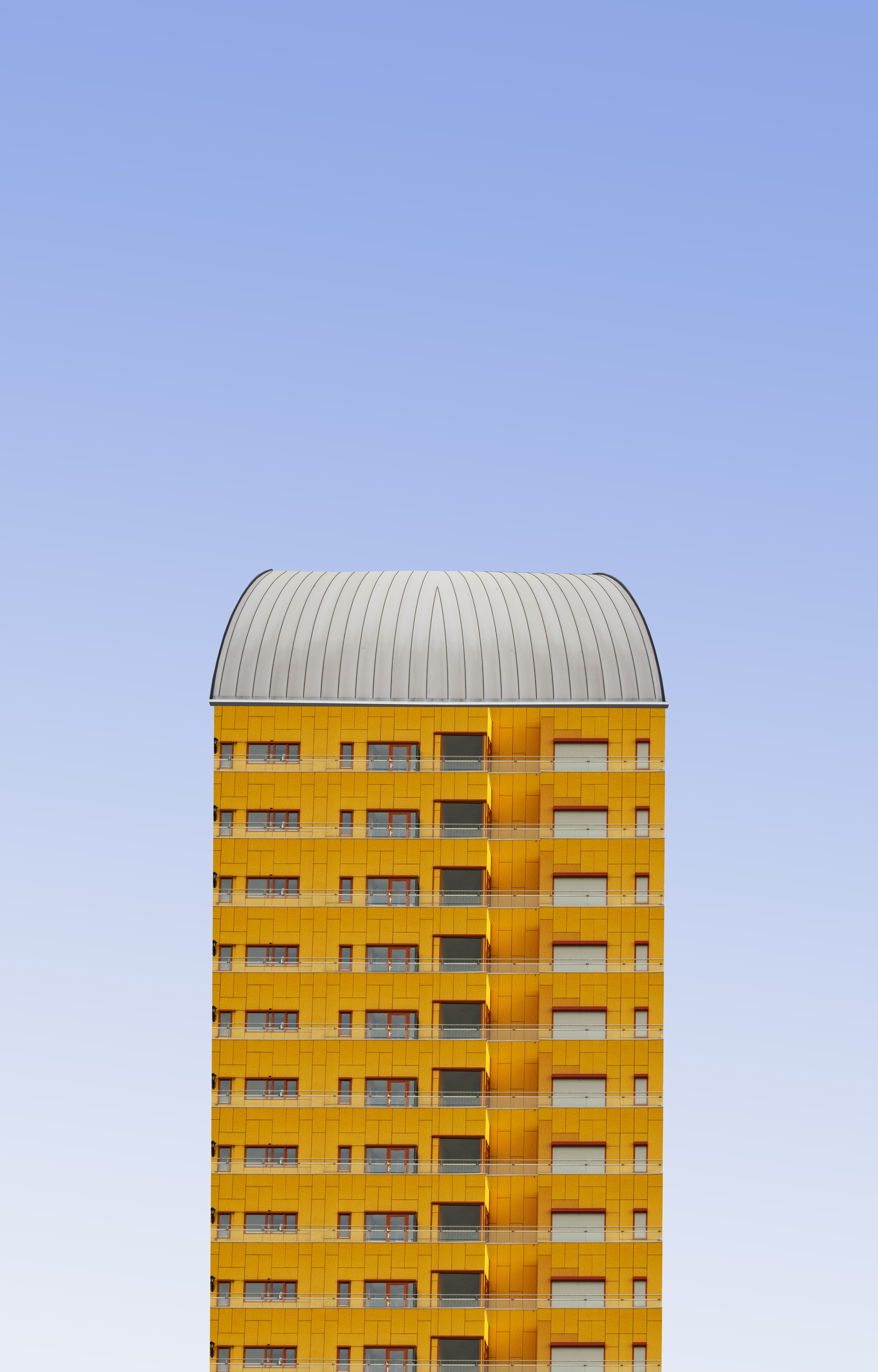 yellow and white building at daytime