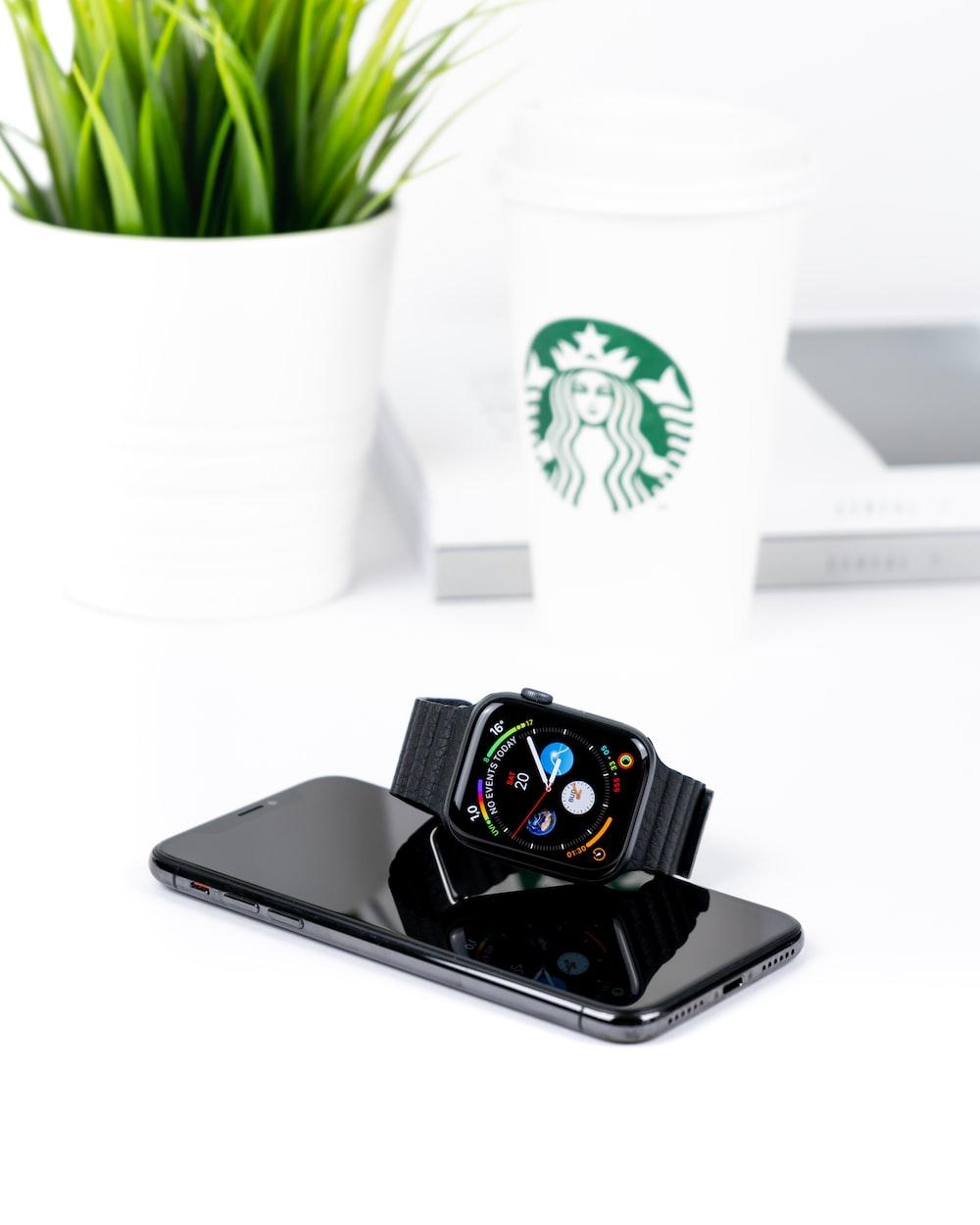 smartwatch on top of smartphone