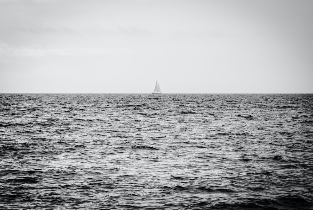sailboat in the middle of ocean