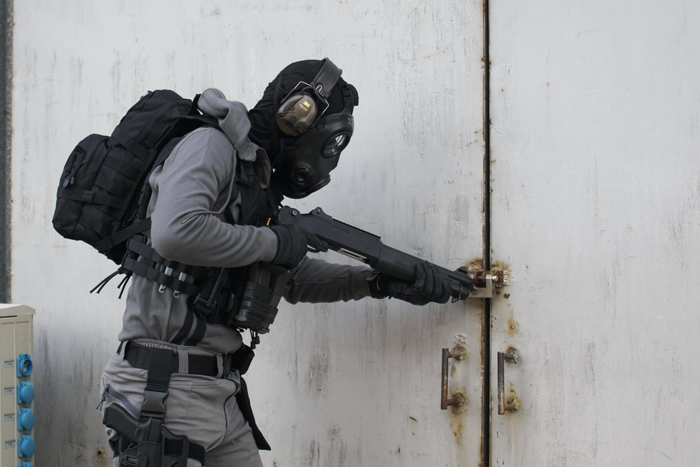 person wearing armor suit carrying shotgun