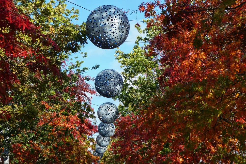 low angle photography of decorative balls hanging