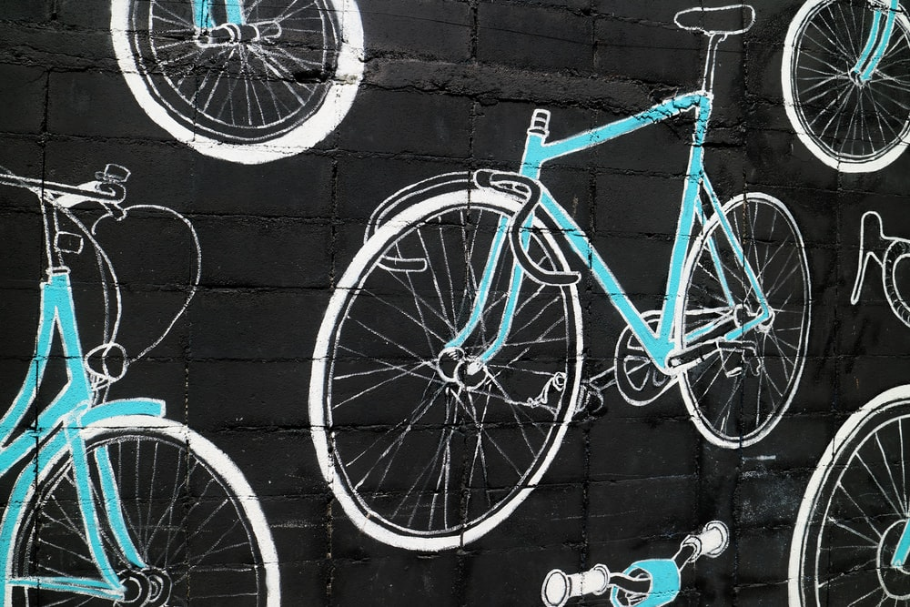 teal and white bicycle wall artwork