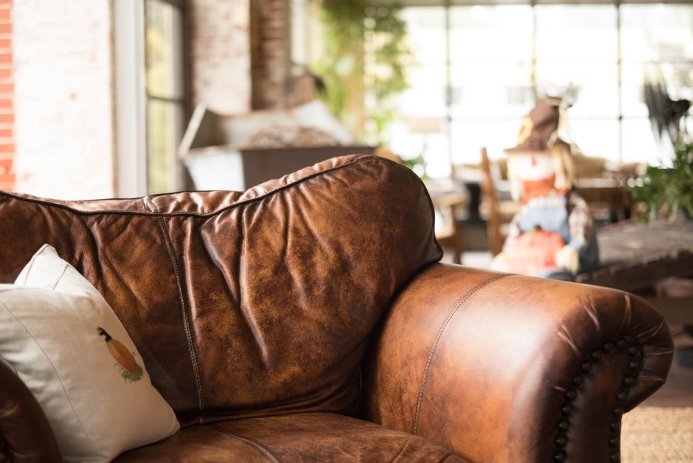 white throw pillow on brown leather armchair