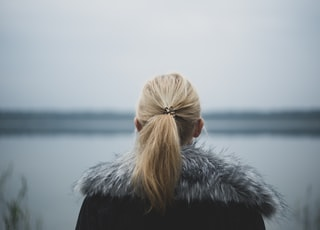 selective focus photography of woman's back