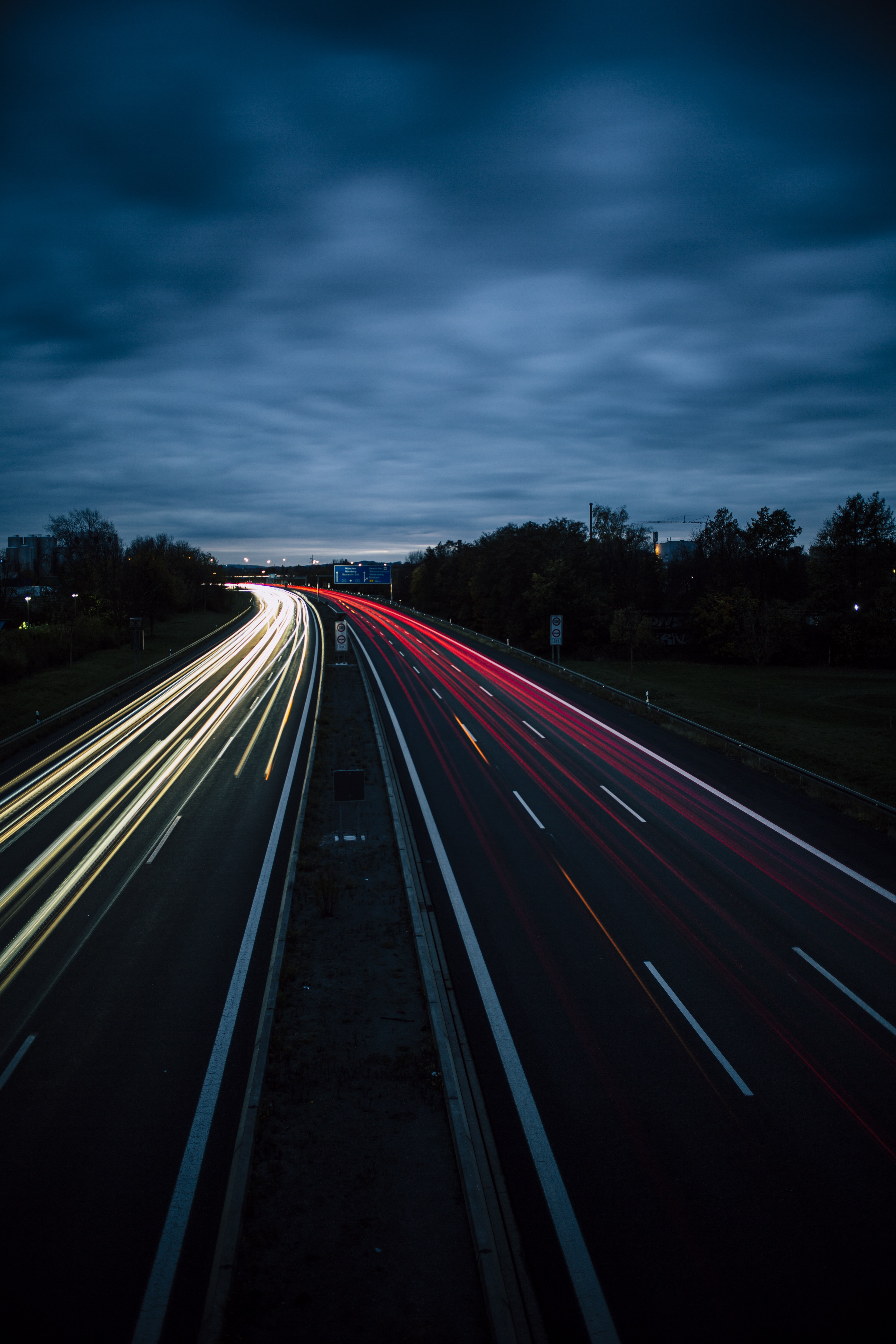 time-lapse photography of vehicle lights on road