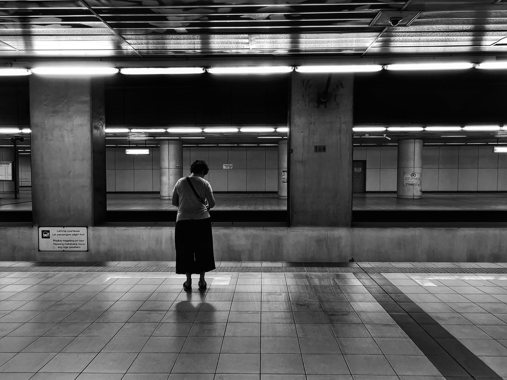 woman standing at the train station