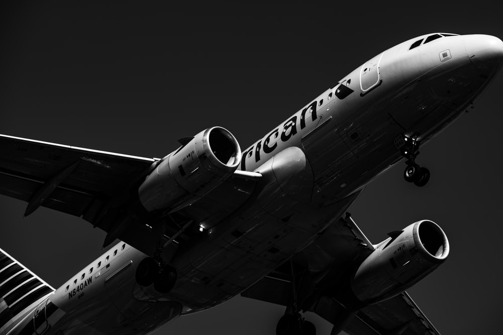 grayscale photo of white and black airliner