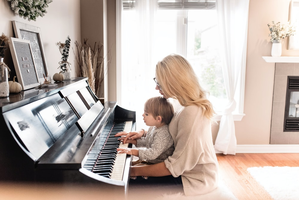 woman and child playing piano