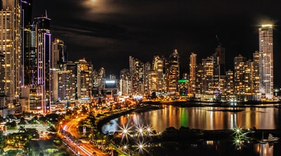 city lights and buildings during nighttime panama zoom background