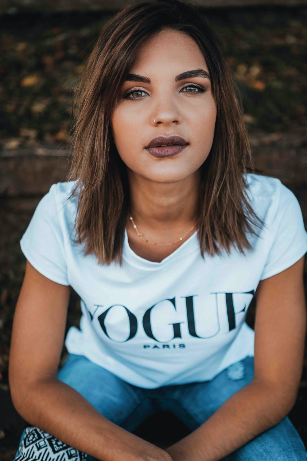 woman in white Vogue t-shirt and blue jeans