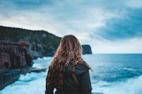 woman standing near sea
