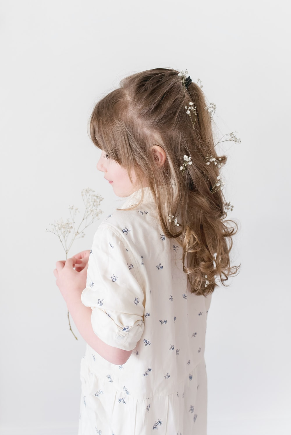 girl wearing white dress