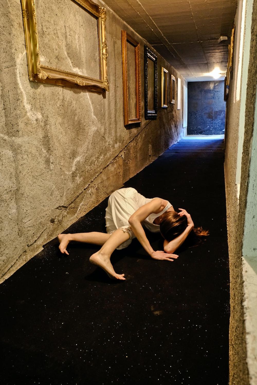 woman lying on hallway
