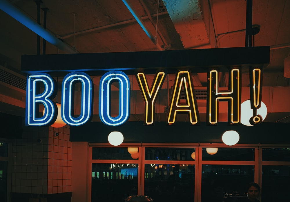 turned-on booyah! neon signage