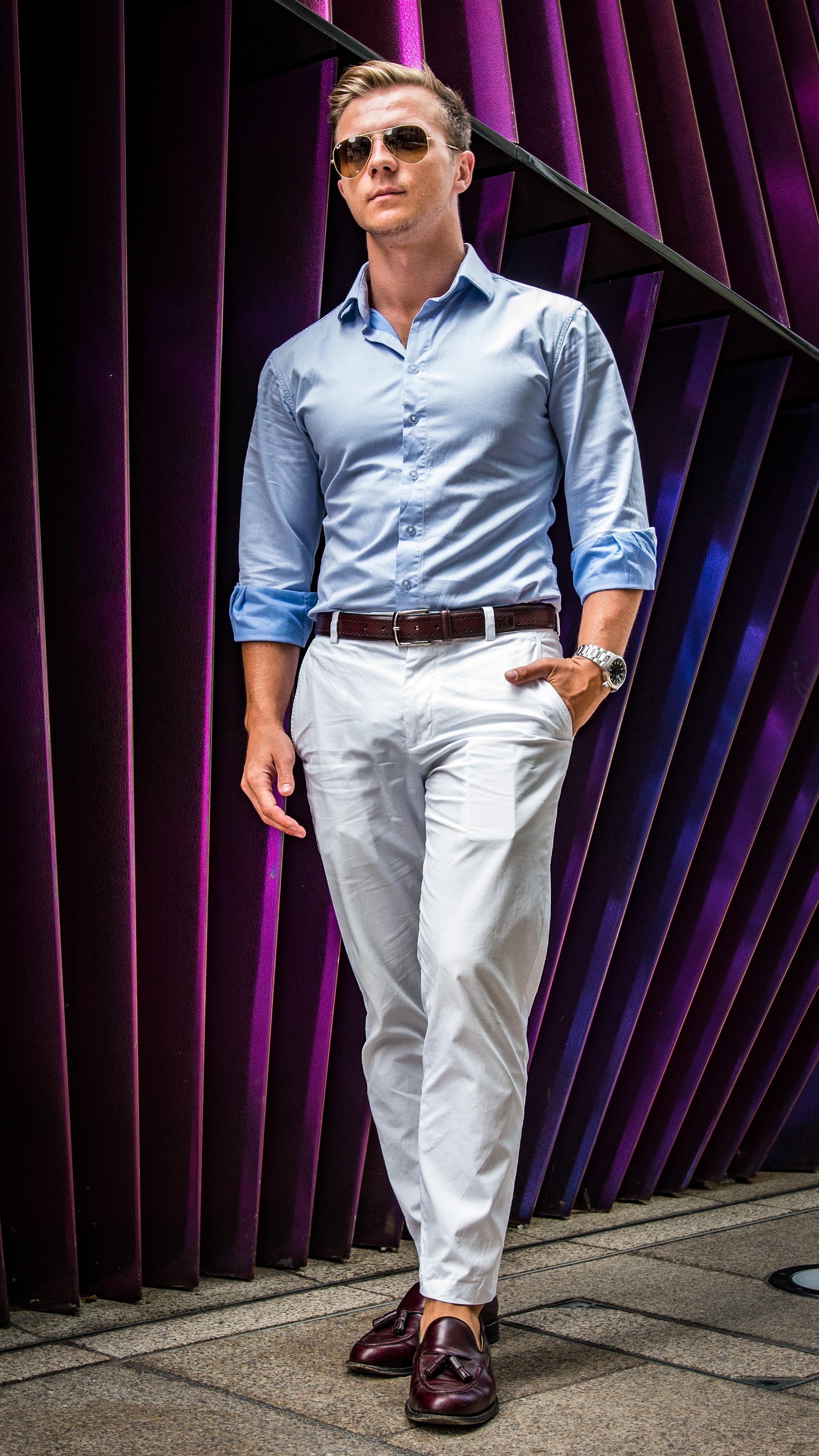man standing purple wall