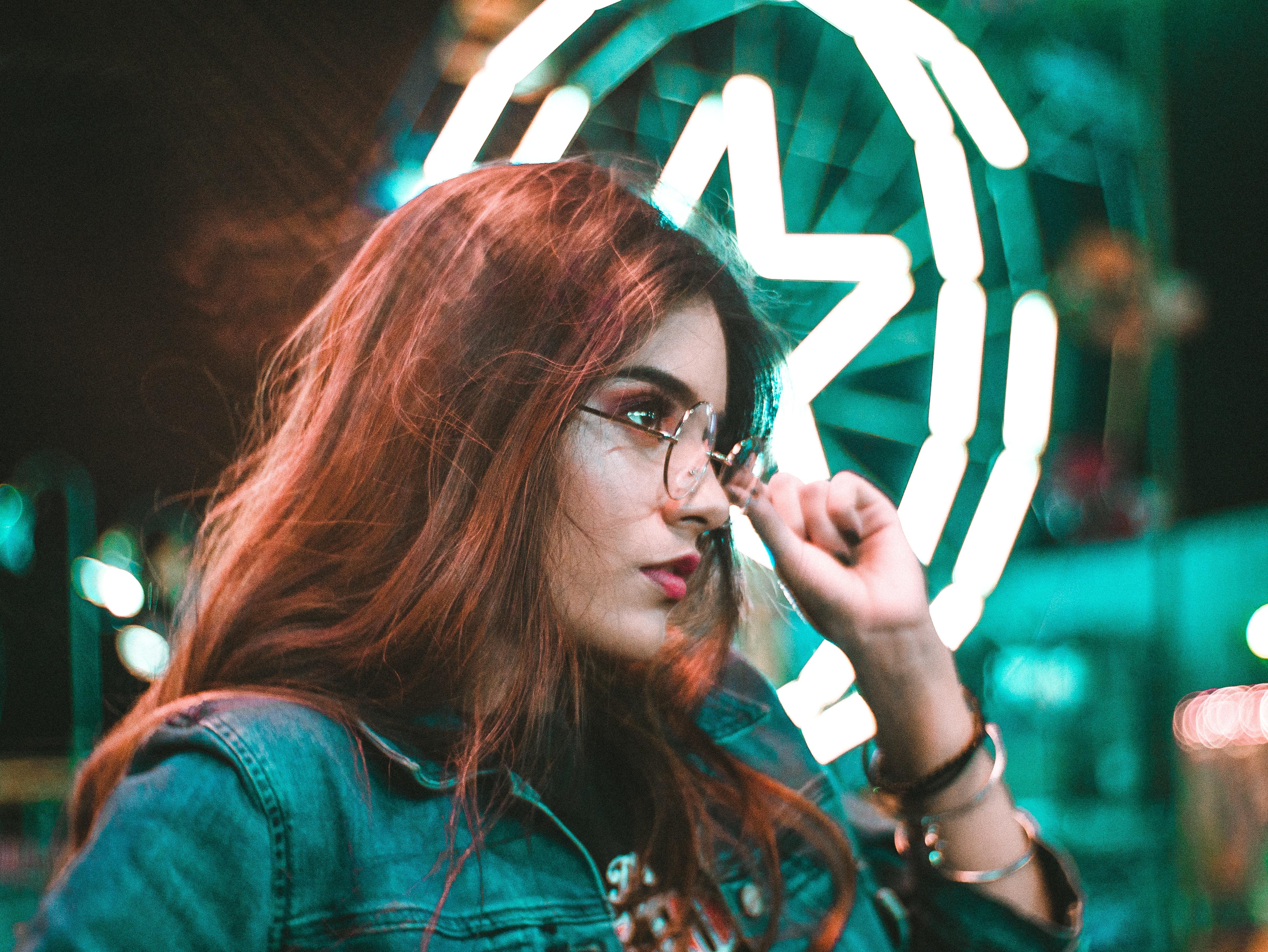 woman touching eyeglasses