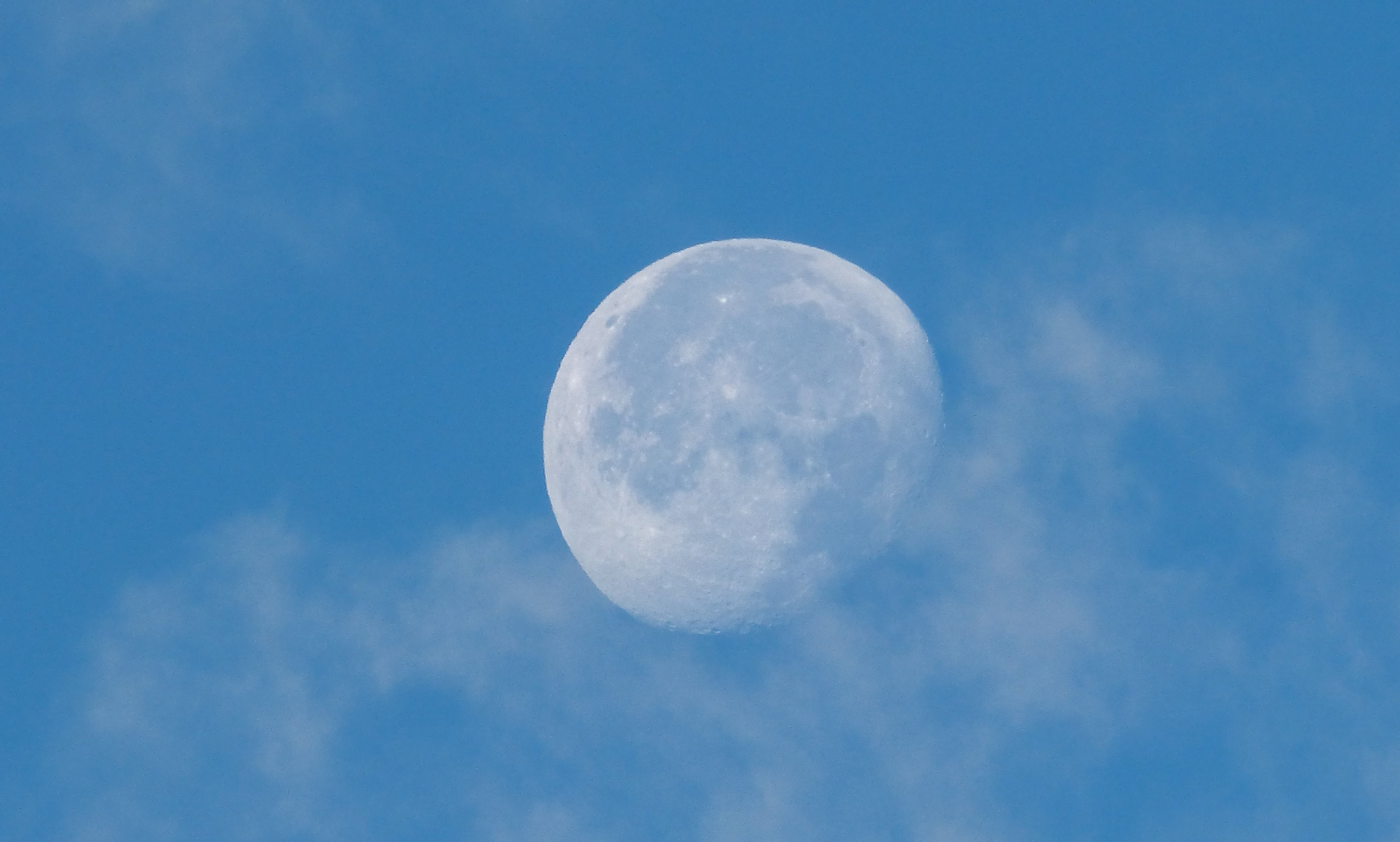 moon surrounded with cirrus clouds