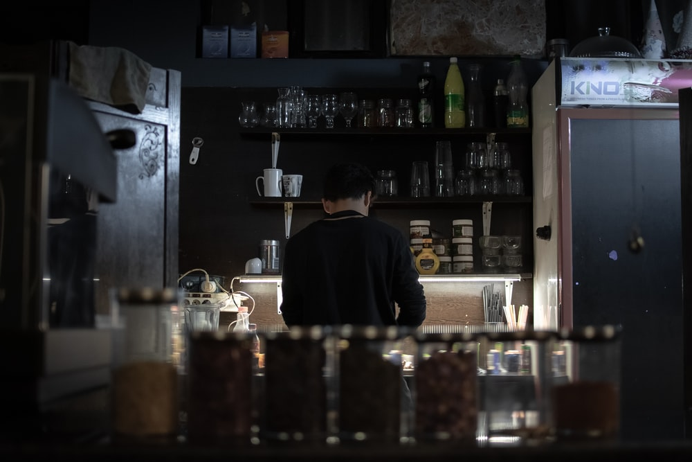 man standing on kitchen area