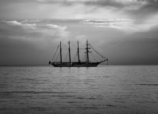 greyscale photo of boat