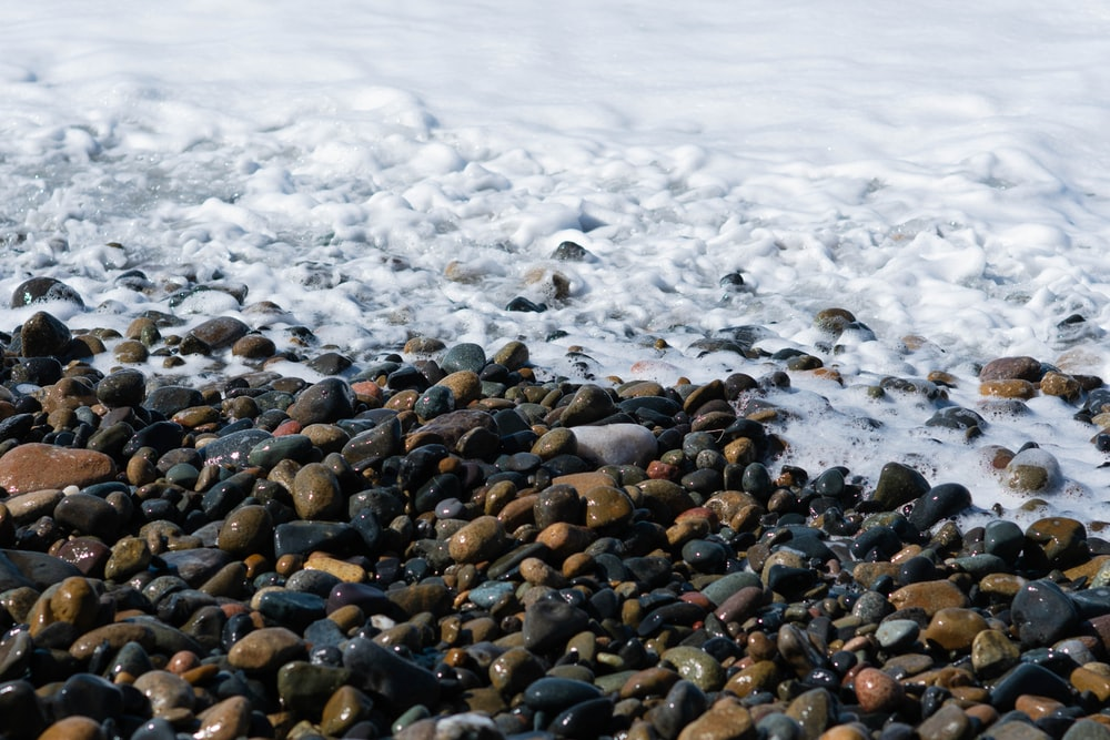stones near body of water during daytime