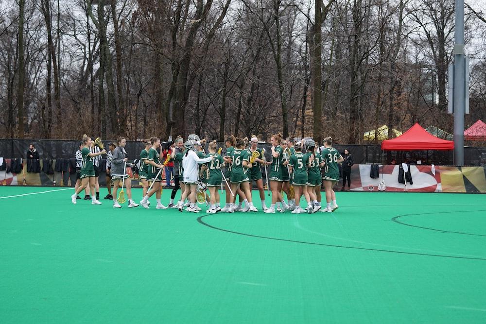 women standing on field