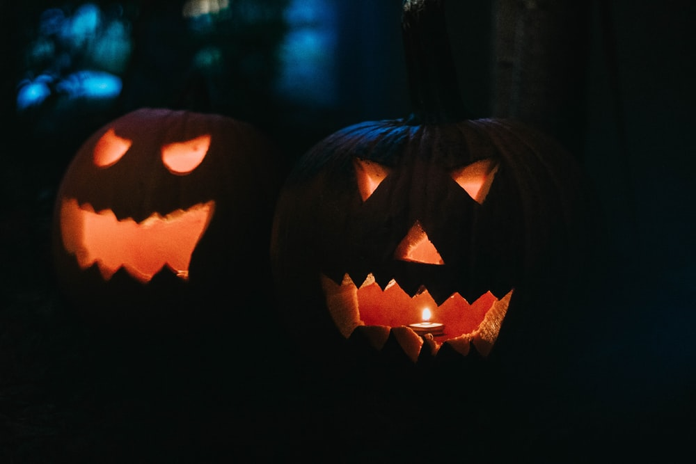 two lighted jack-o'-lanterns