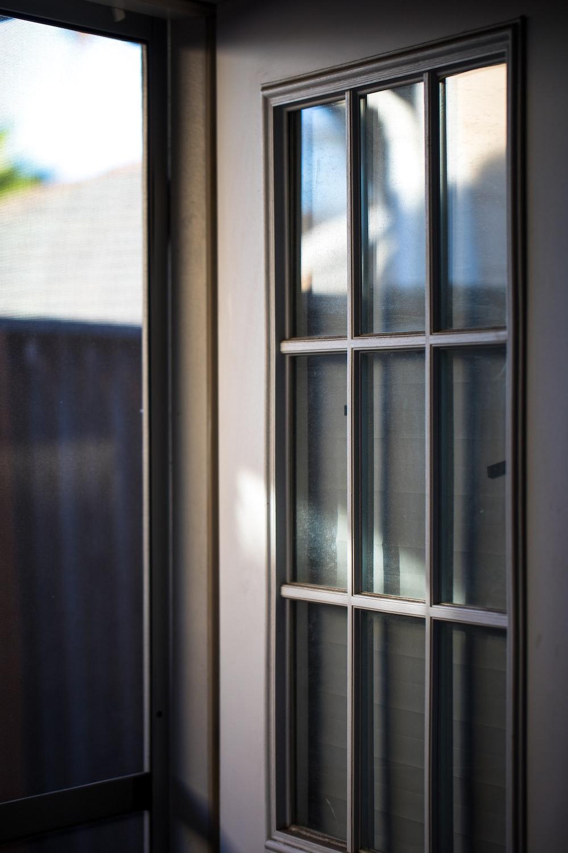 opened white wooden framed glass door