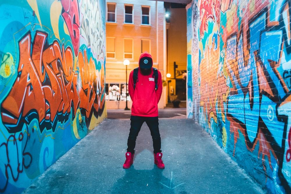 man standing between walls