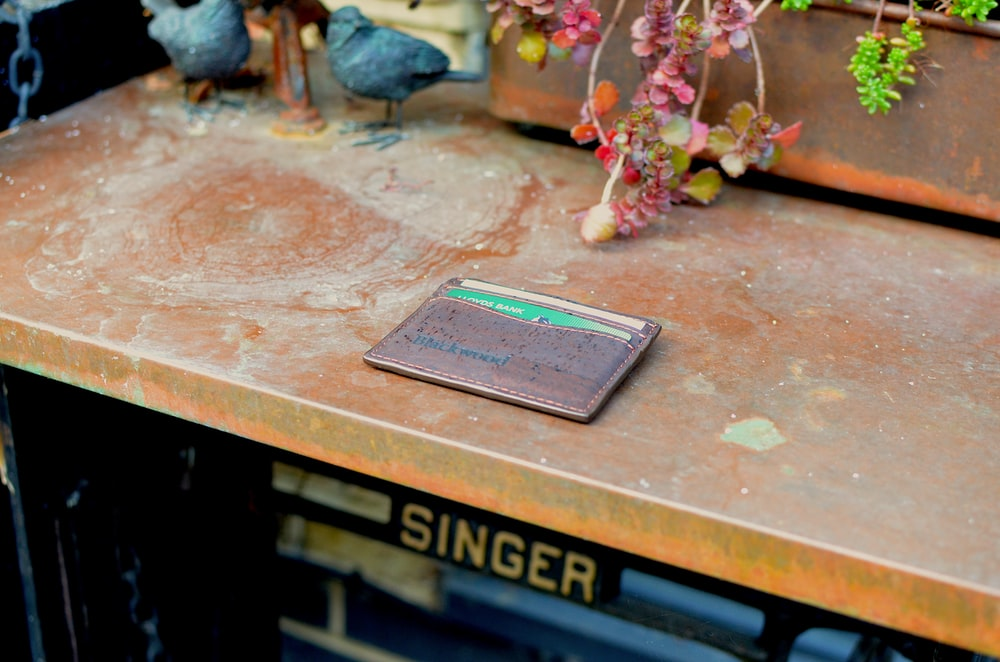 brown Singer sewing table