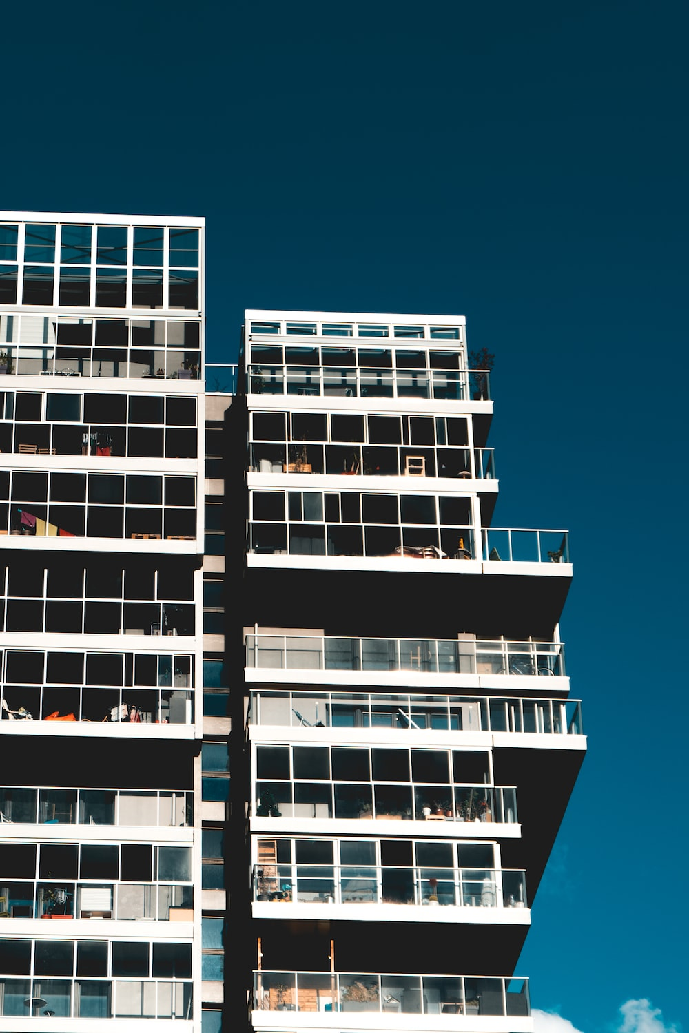 gray and brown apartment building under sunny sky