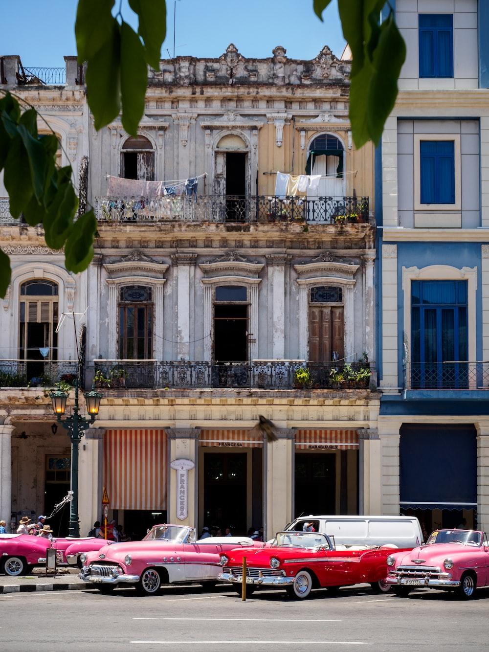 vehicle parked beside concrete buildings