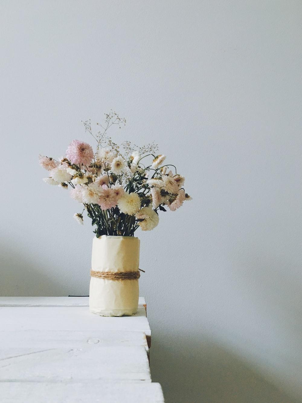 white petaled flowers in white vase