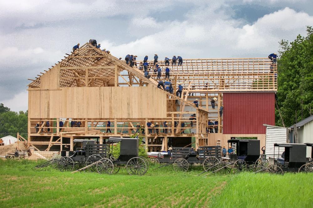 people making house during daytime