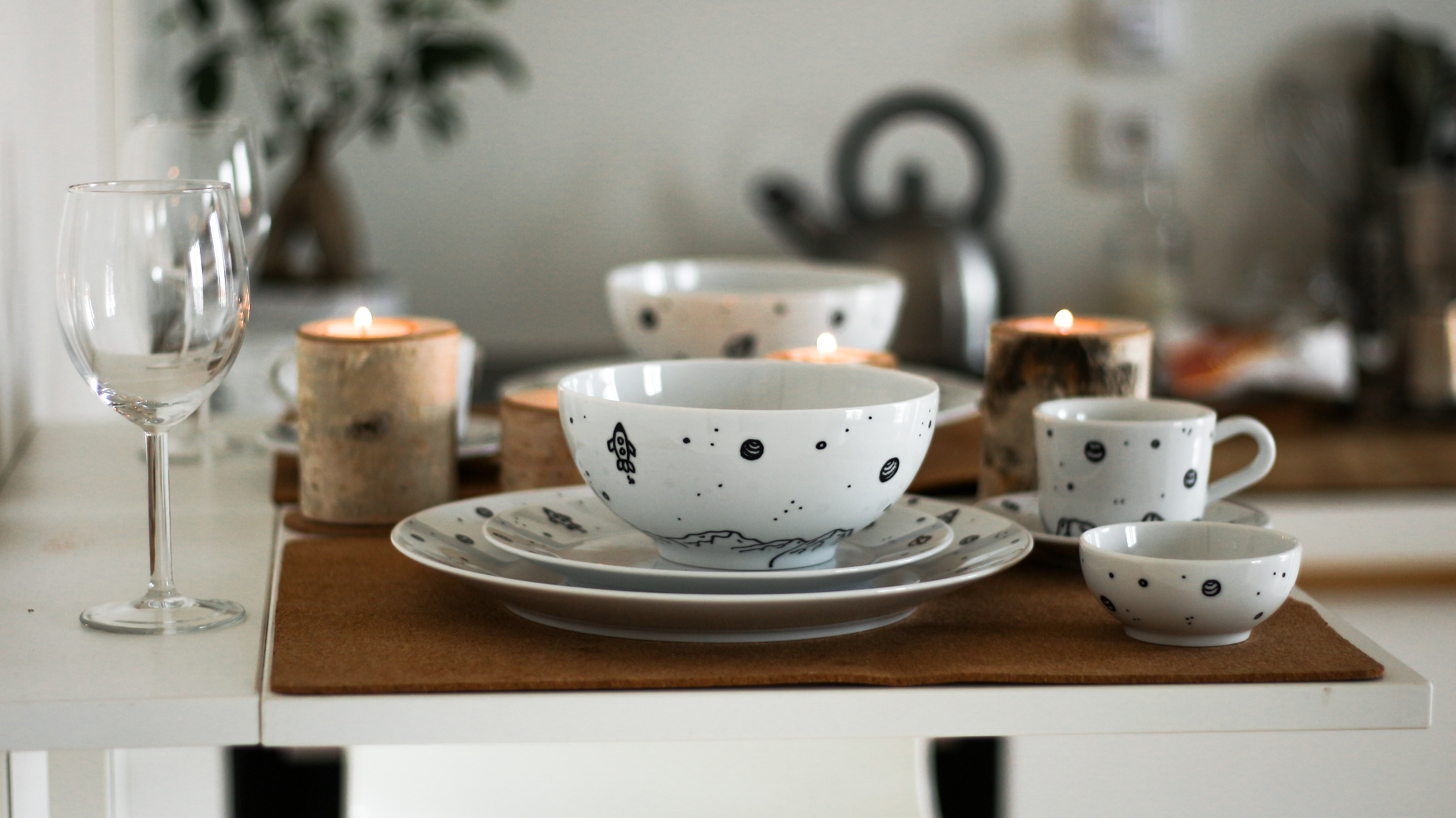 white and black ceramic wares on table