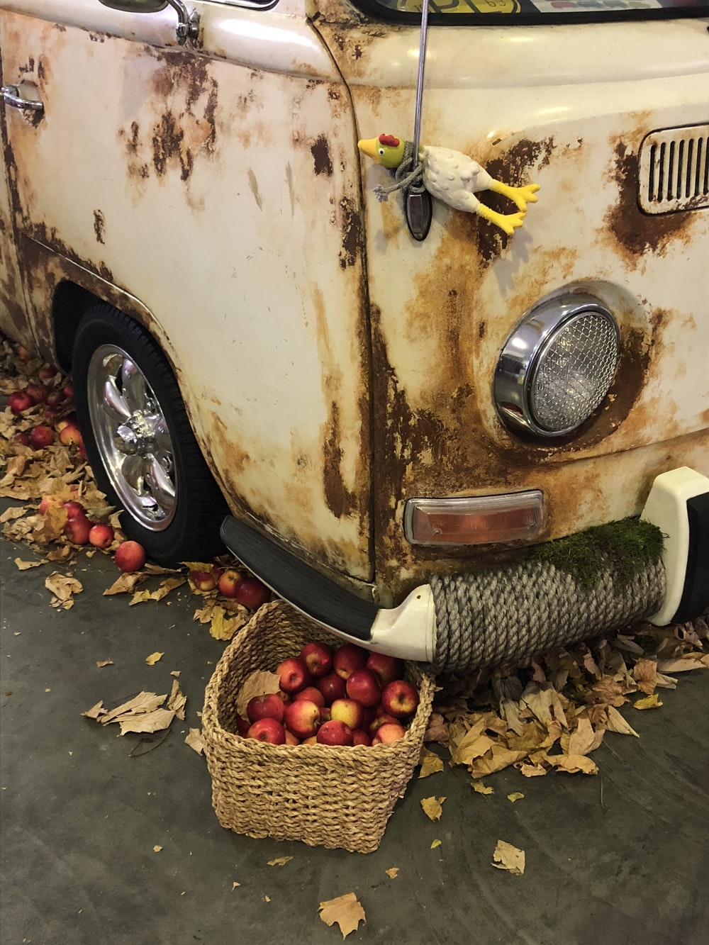 apples in brown woven basket under white van