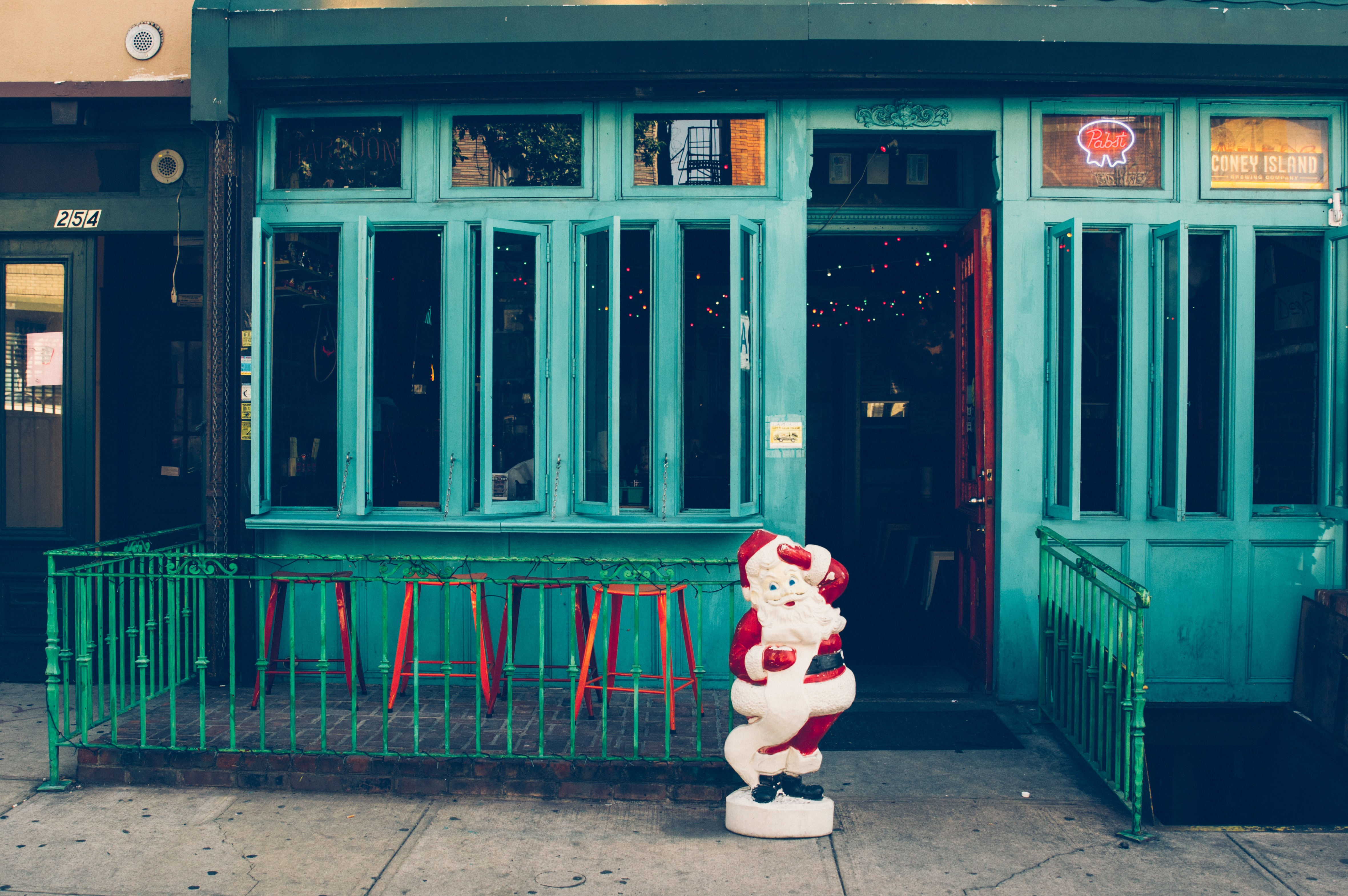 Santa Claus statuette standing outside beside the door
