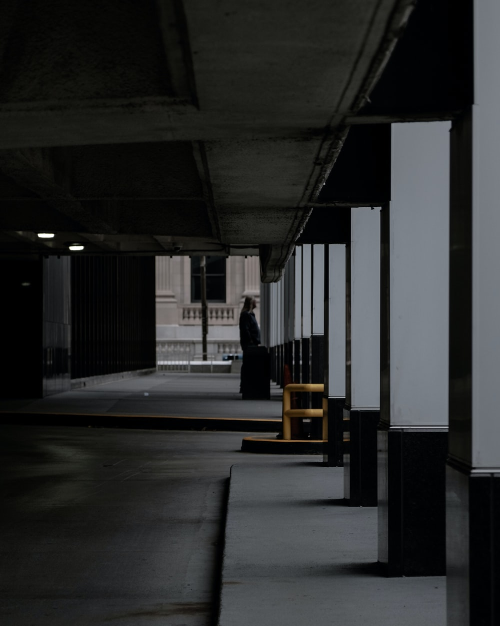 person standing near building