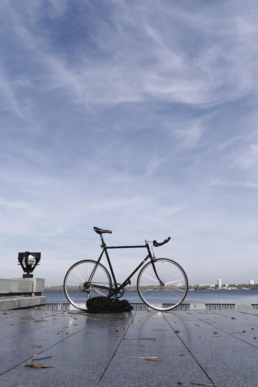 black backpack near black bicycle