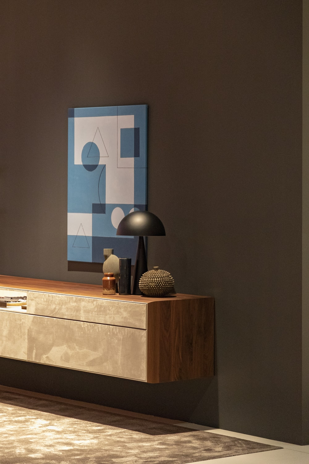 gray table lamp on brown sideboard