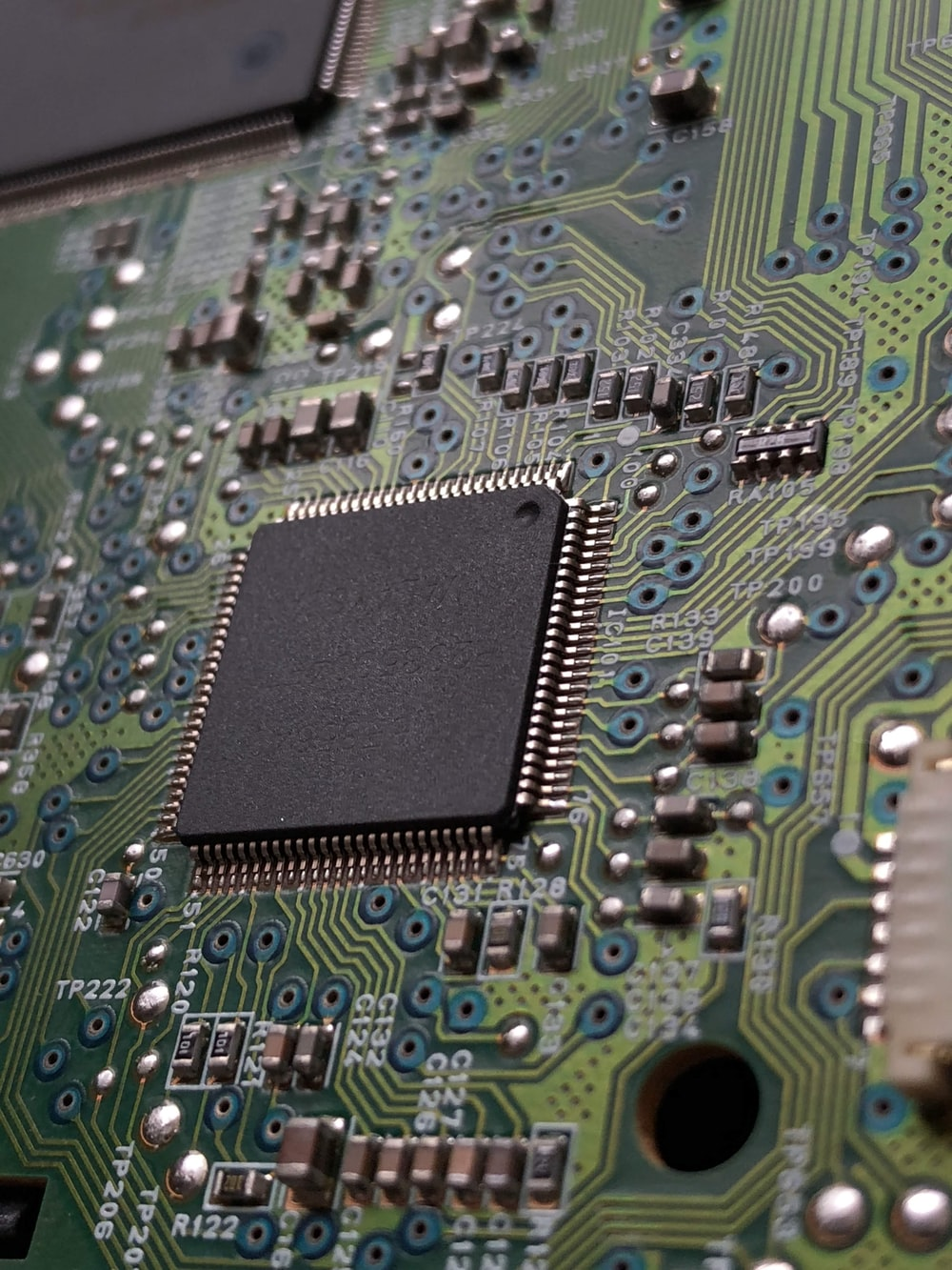 close-up photography of green motherboard