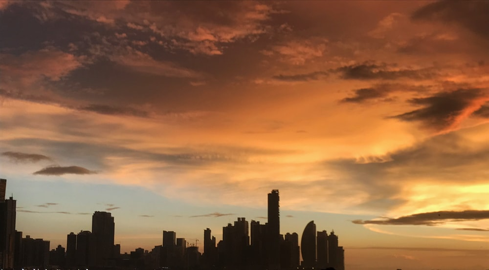 silhouette of buildings under golden hour