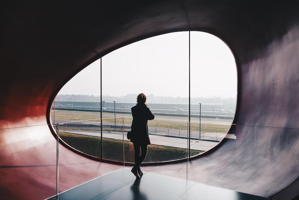 man standing on gray platform