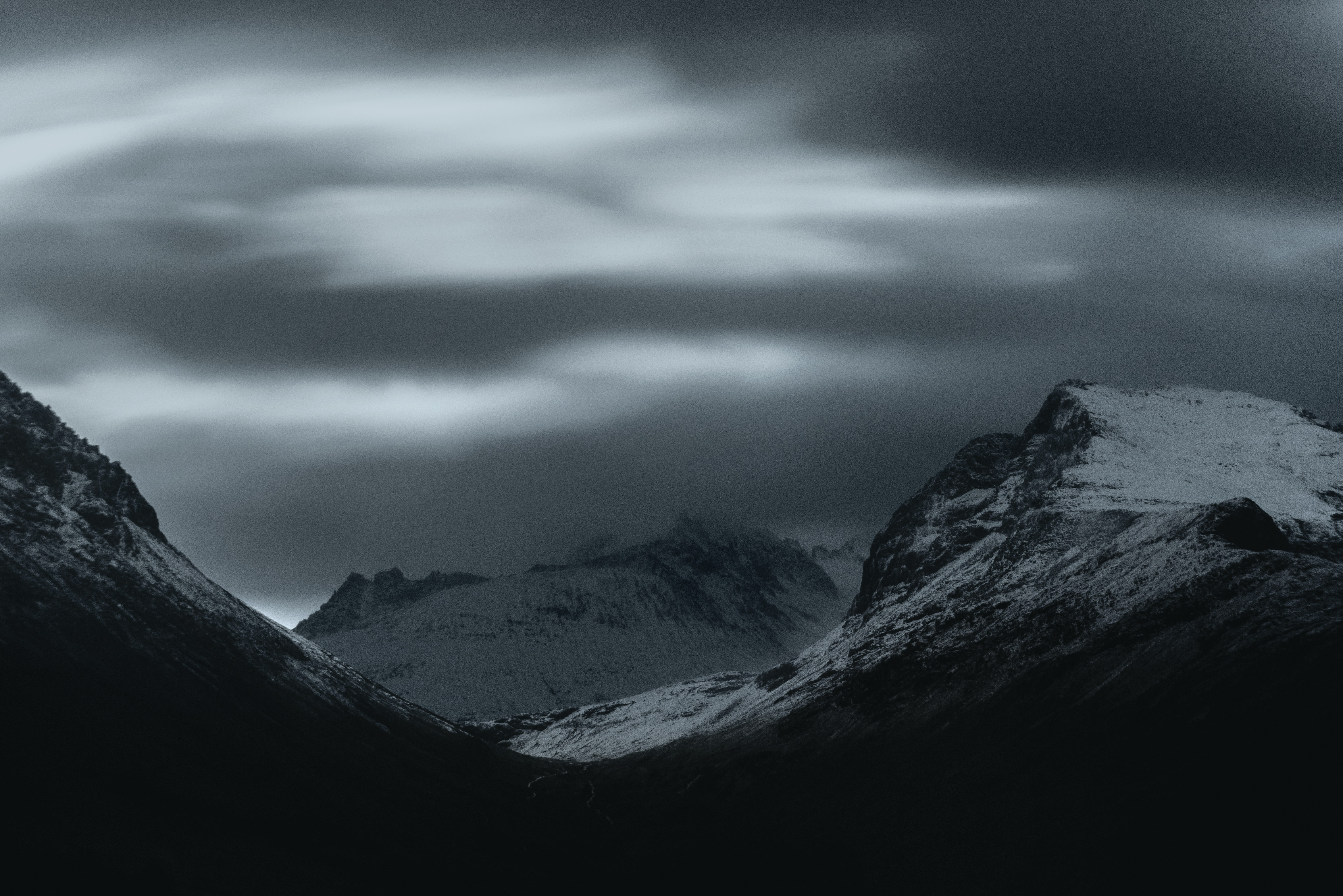 mountain covered in snow at night