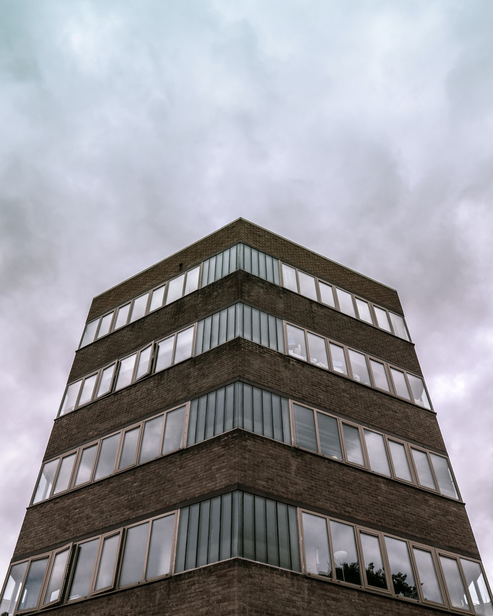 low-angle photo of brown building