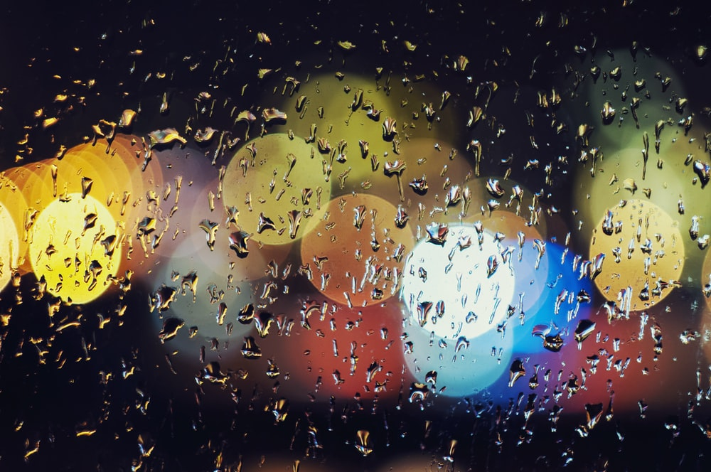 water droplets on glass panel at nighttime